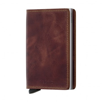 Slimwallet Vintage:  Secrid Slimwallet Vintage has a carefully abraded surface and wax finish that gives it a stonewash look. It's more...