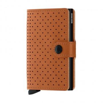 Miniwallet Perforated - Lompakko:  Secrid Miniwallet Perforated -lompakon nahka on saanut vaikutteensa klassisesta ajohanskasta. Hienovaraisen...