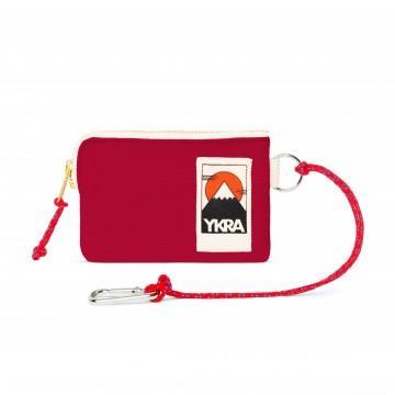 Mini Wallet - Lompakko:  YKRA Mini Wallet -lompakossa on karabiineri, jolla sen saa kiinnitettyä laukkun. Vetoketju pitää kaiken turvassa...