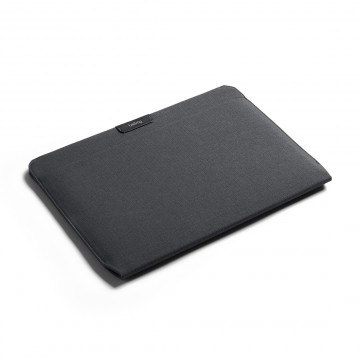 Laptop Sleeve:  Cover and prorect your laptop in a tailored, easy access sleeve without the bulk. The magnetic closure lets you...