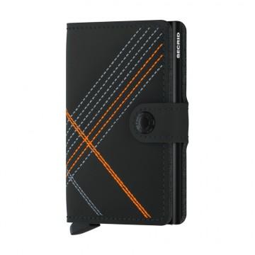 Miniwallet Stitch Linea Matte - Lompakko:  Secrid Miniwallet Stitch Linea Matte -lompakossa on mattapintainen nahka ja värillinen tikkaus.   Miniwallet on...