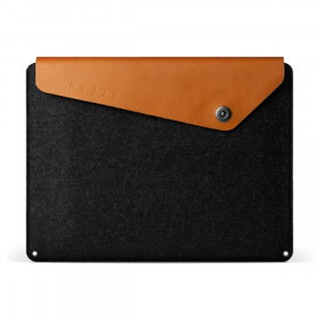 MacBook Sleeve:  Crafted out of a combination of felt and vegetable-tanned leather, this sleeve is designed to fit the Macbook...
