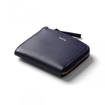 Pocket Mini Wallet:  Pocket Mini is a small, square format wallet for those who want to pack light. Magnetic snap closure and coin pocket...