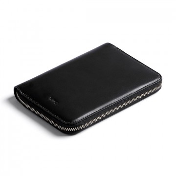 Travel Folio:  The Bellroy Travel Folio lets you feel secure, arranged and relaxed in your travels. The leather divider inside lets...